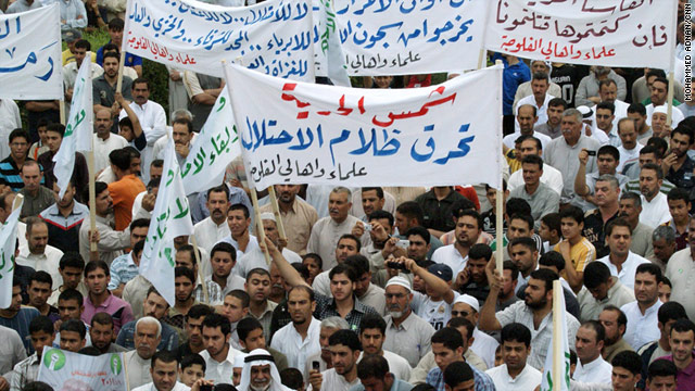 Nearly 300 protesters demonstrate outside the provincial council building in Falluja, Iraq, on Friday.