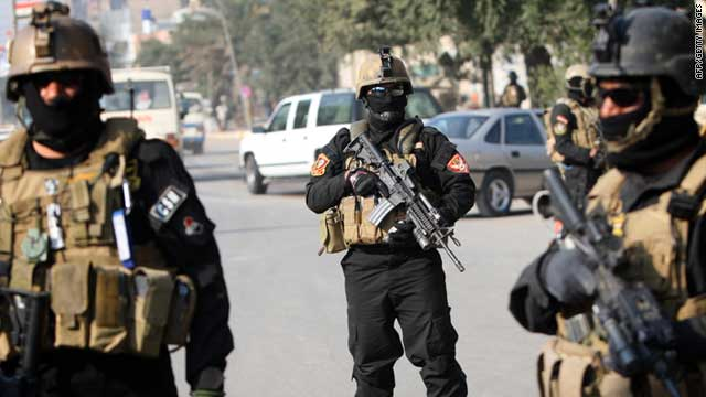 Members of an Iraqi anti-terror unit stand guard at a checkpoint in Baghdad in January.