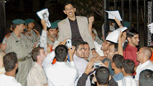 Abdulhadi Al-Khawaja is greeted by supporters after being released from prison in Manama, Bahrain, in November 2004.