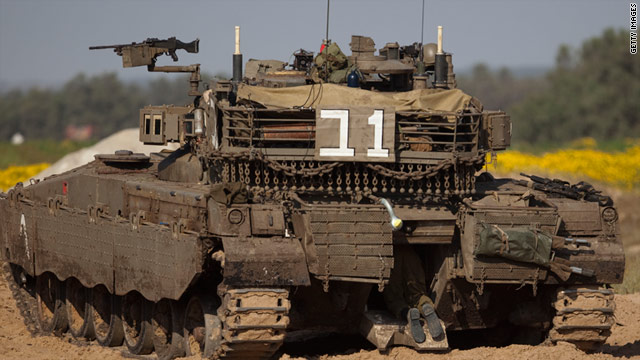 An Israeli soldier enters a tank near the Israeli side of the Gaza border.