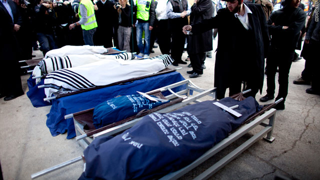 Mourners attend the funeral of Udi and Ruth Fogel and their three children on March 13 in Jerusalem.