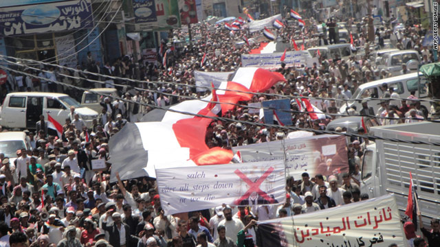 Demonstrators march in Yemen's Ibb province, about 120 miles from the capital, on Sunday, calling for the president to resign.