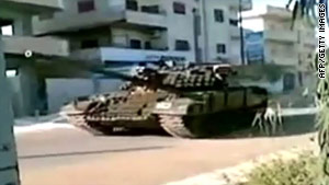 A still taken from a YouTube video on April 25, 2011, reportedly shows an army tank in the town of Daraa.