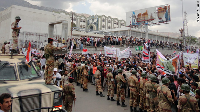 Yemeni soldiers face anti-government protesters in Taiz, south of the capital Sanaa, on April 27.