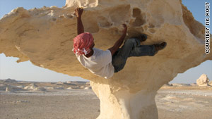 Nicknamed &quot;Monkey&quot; by some, Tik Root climbs in Egypt's White Desert.