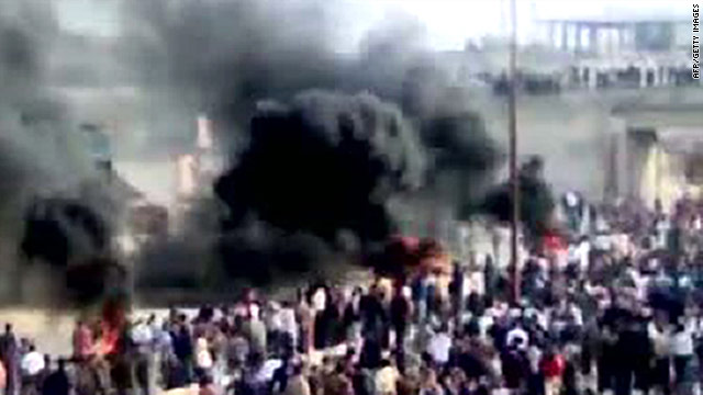 A frame from a video downloaded from YouTube shows thick smoke rising during a demonstration in Moaret Al-Noman on Friday.