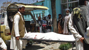 A victim's body is carried through Ghazni, Afghanistan, after Sunday's attacks.