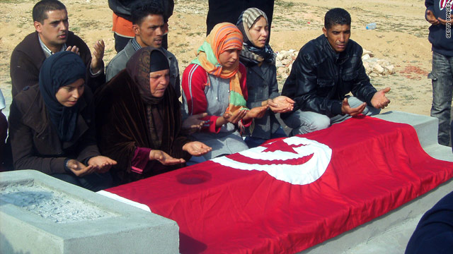 Mohamed Bouazizi's family praying at his grave on January 19, 2011.