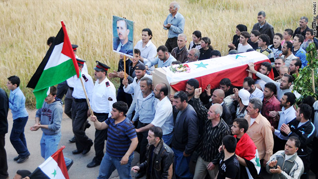 Released by the Syrian Arab News Agency on Sunday, this photo shows a funeral procession for a Syrian police officer.
