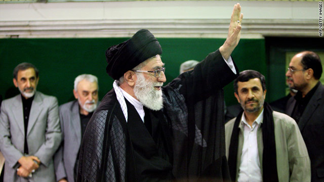 Mahmoud Ahmadinejad is among onlookers at a religious ceremony attended by Ali Khamenei, center, in Tehran on Saturday.