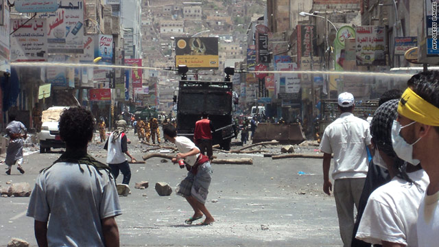 Yemeni security forces use water cannons to disperse anti-government protesters in Taiz on May 9, 2011.