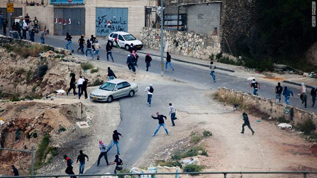 Palestinian youth throw stones during clashes with Israeli police on May 13, 2011, in Issawiya, East Jerusalem.