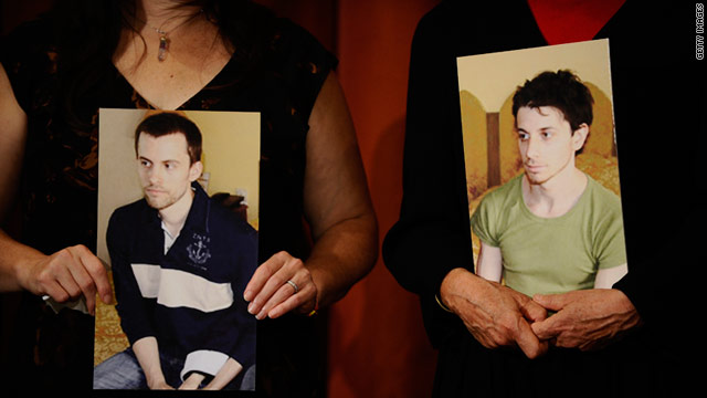 The mothers of Shane Bauer (left photo) and Josh Fattal hold their sons photos during a news conference in September 2010.