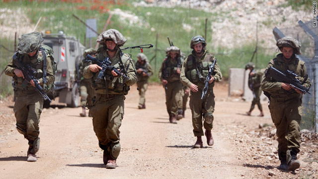 Israeli soldiers patrol along the border fence between the Golan Heights and Syria on May 20.