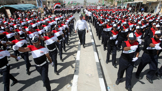 "Tens of thousands marched in a military-style parade and chanted ""Get out, occupier"" in Sadr City on Thursday."