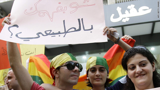 "Protesters in Beirut, Lebanon, on International Day Against Homophobia 2010. Their banner reads ""What do you know about being normal?"""