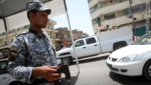 An Iraqi policeman in Baghdad holds a device that checks for explosives. Attacks in recent months have left dozens dead.