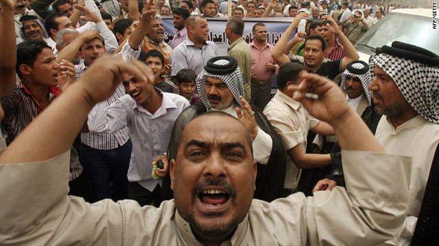 Iraqi men demonstrate in support of Prime Minister Nuri al-Maliki in Baghdad's Tahrir Square on Friday.