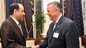 Iraqi Prime Minister Nuri al-Maliki, left, and Rep. Dana Rohrabacher shake hands in Baghdad on Friday.