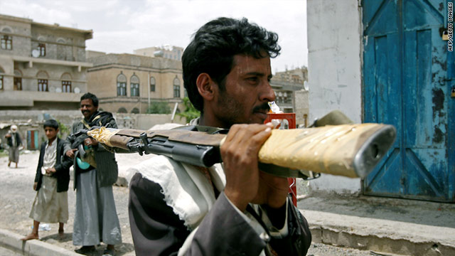 An armed, anti-government Yemeni man patrols a street in Sanaa, Yemen, on Saturday.