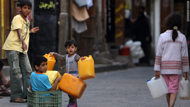 Children carry gerry cans to fill with water as Yemen is gripped by water shortage