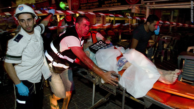 A victim is taken to the hospital after a gas canister exploded in a building in Netanya, Israel, on Thursday.