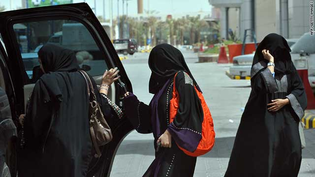 Women get into the backseat of a vehicle in Saudi Arabia's capital Riyadh on June 14, 2011.