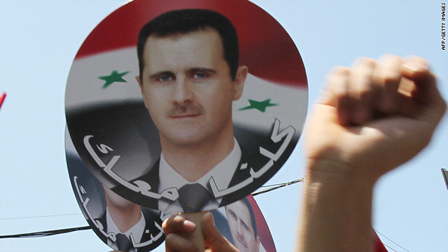 Lebanese citizens and Syrians living in Lebanon hold pictures of Syrian President Bashar al-Assad during a rally outside the Russian embassy in Beirut on Sunday in support of Assad's regime.