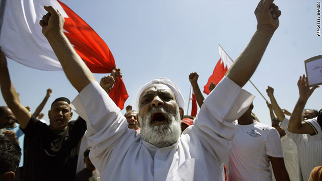 Shiite mourners chant anti-government slogans in the town of Sitra on March 20, 2011.