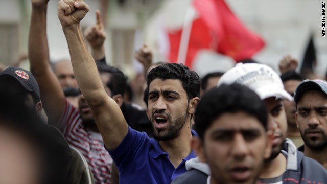 Bahraini Shiite men chant anti-government slogans in the Shiite town of Sitra on March 18.
