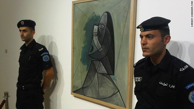 "Security guards keep close to the ""Buste De Femme"" by Pablo Picasso. It's on loan from a museum in the Netherlands."