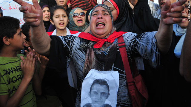An Egyptian woman shouts slogans during a rally on the first anniversary of the death of Khaled Said on June 06.