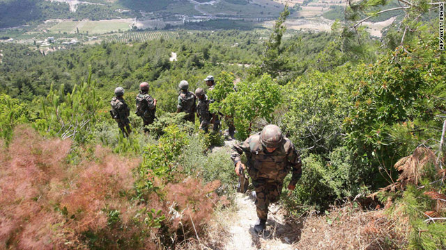 Syrian soldiers along the Syrian-Turkish border near the village of Khirbet al-Joz in the province of Idlib on June 29, 2011.