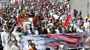 Bahraini Shiite Muslims with the coffin of Abdulrassul Hujairi, who went missing in the crackdown,  near Manama on March 21, 2011.