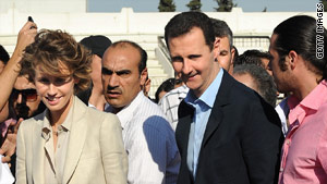 Syrian President Bashar al-Assad (R) and First Lady Asma al-Assad in Damascus on June 30, 2011