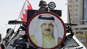 A picture of Bahraini King Hamad bin Issa al-Khalifa decorates a tank in Pearl Square, March 19, 2011.