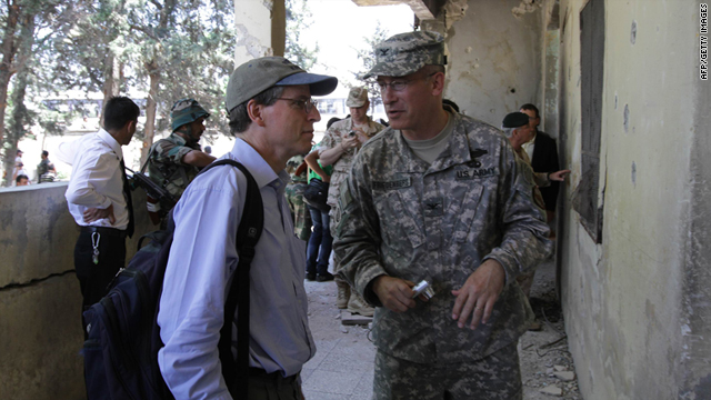 U.S. Ambassador to Syria Robert Ford, left, speaks to a U.S. military attache on a guided government tour in Syria, June 20, 2011.