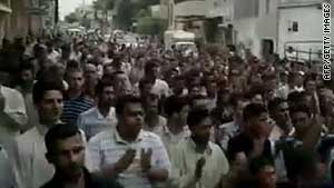 An image taken from footage uploaded on YouTube shows Syrian anti-government protesters marching in Hama Friday.