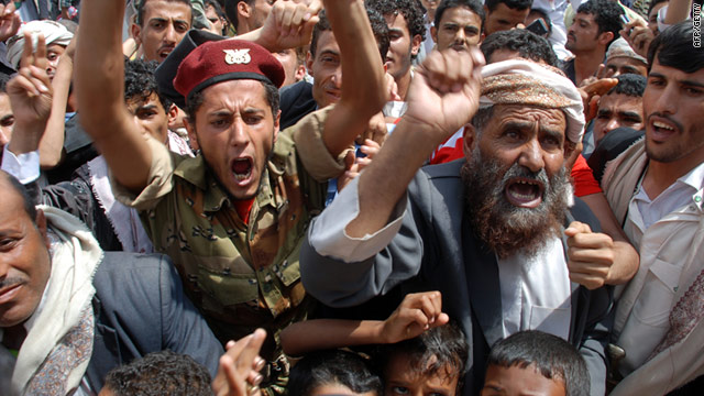 Yemeni anti-government protesters shout slogans during a rally in Sanaa on July 8.