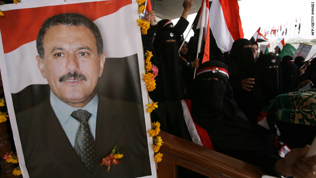 Yemeni men and children hold up portraits of President Ali Abdullah Saleh during a pro-regime rally in Sanaa on July 1.