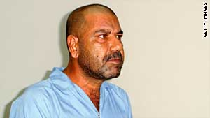 (file photo) Watban Ibrahim Hassan, half brother of ex- Iraqi dictator Saddam Hussein, is questioned by the Iraqi Special Tribunal on July 25, 2005.