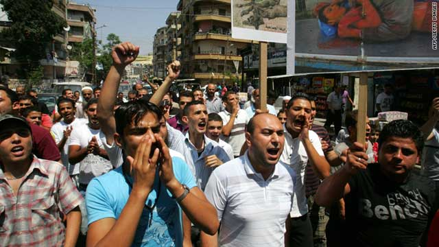 Lebanese and Syrian anti-Assad demonstrators protest in the northern Lebanese coastal city of Tripoli on Friday.