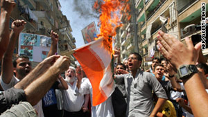 Demonstrators protest in the Lebanese coastal city of Tripoli on Friday, demanding the ousting of Bashar al-Assad.