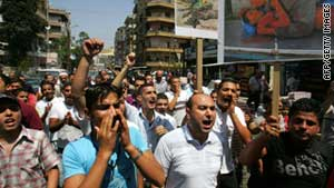 Lebanese and Syrian anti-Assad demonstrators protest in the  Lebanese city of Tripoli on Friday.