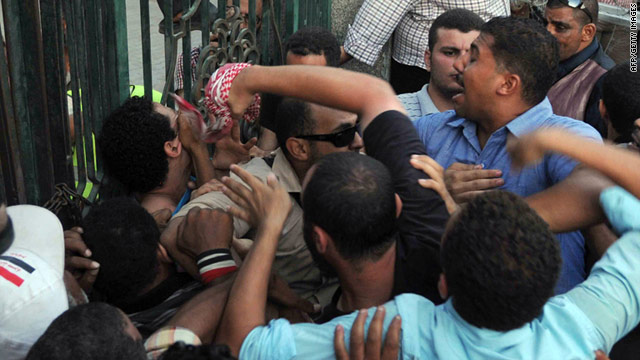 Protesters clash with loyalists of the ruling military council outside the defence ministry in Cairo on July 23.