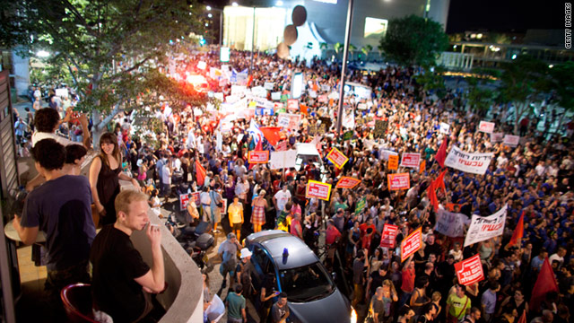 Israelis march to protest against rising housing prices and social inequalities in Tel Aviv, Israel on July 23.