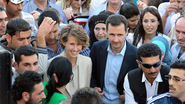 Syrian President Bashir al-Assad and his wife in Damascus on June 30, 2011 meeting regime supporters.