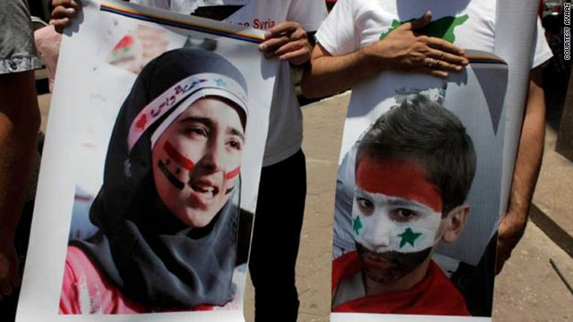 "Protesters outside the Syrian embassy in Cairo call for the release of the country's ""disappeared."""