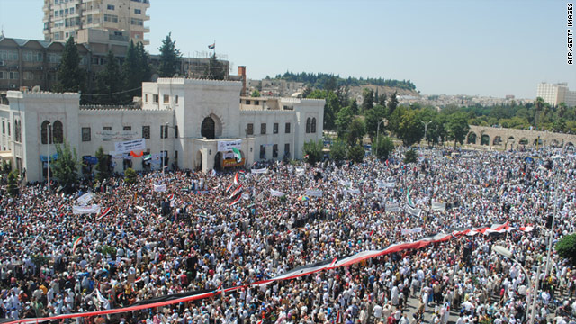 Syrians demonstrate against the government after Friday prayers in Hama on July 29, 2011.