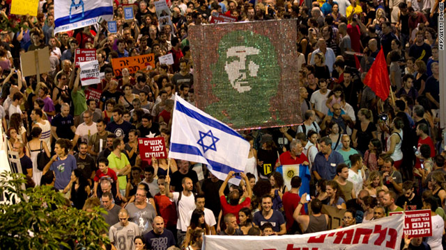 Tens of thousands of demonstrators in Tel Aviv on Saturday protest soaring housing prices in Israel.